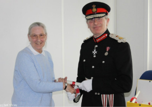 Carol being presented with her award by the Lord Lieutenant of Sussex