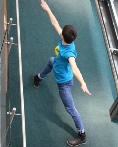 The dancers performed their dynamic piece on the mezzanine floor above the stage